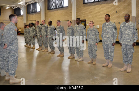 The 59th Troop Command officially welcomed 12 Soldiers to the unit during a patching ceremony held at the Bluff - Stock Photo