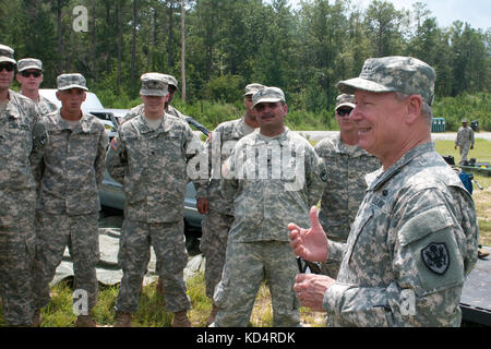 U.S. Army Gen. Frank J. Grass, Chief, National Guard Bureau and member of the Joint Chiefs of Staff, talks with - Stock Photo