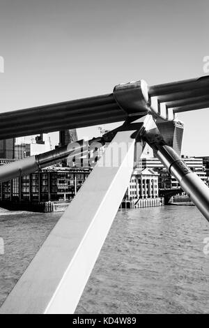 Black and White Monochrome Image of a Close Up of trhe Millennium Footbridge in London, United Kingdom Crossing - Stock Photo