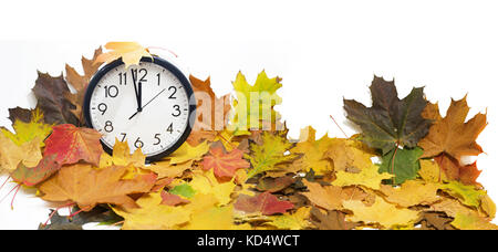 Isolated electronic wall clock. Autumn abstraction. Fall back time. - Stock Photo