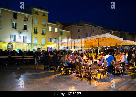 Lively night-time atmosphere and people at restaurants at Place des Cardeurs, Aix en Provence, France - Stock Photo