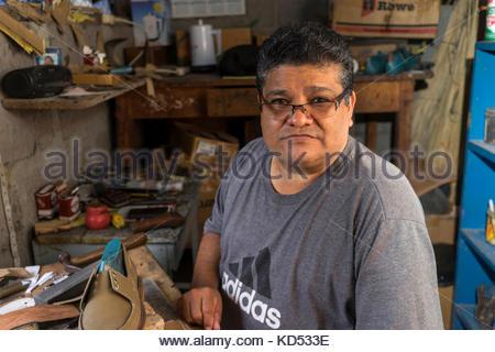Cobbler in workshop - Stock Photo