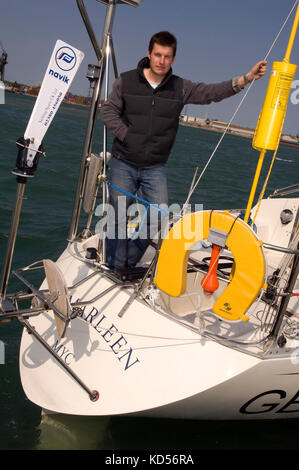 Yachtman Will Sayer with his yacht in Marchwood Yacht Club. - Stock Photo