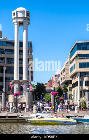 WASHINGTON DC-May 24, 2015: Georgetown waterfront viewed from the Potomac River on a sunny summer day. Bustling - Stock Photo