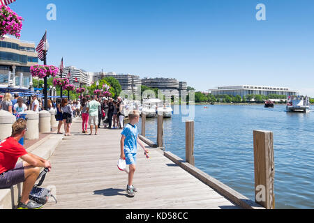 WASHINGTON DC-May 24, 2015: Georgetown waterfront scene along the Potomac River on a sunny summer day.  Crowds of - Stock Photo