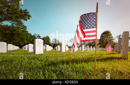 WASH DC-May 25, 2015: Arlington National Cemetery on Memorial Day. Every grave decorated with an American flag . - Stock Photo