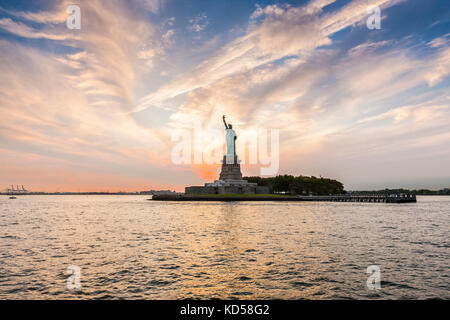 Statue of Liberty at sunset, New York City - Stock Photo
