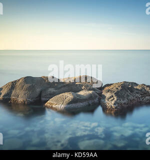 Rocks and sea in zen style. Long exposure photography - Stock Photo