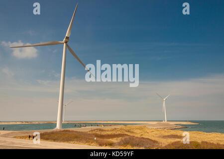 Big white windmills farm near Brouwers-dam in Netherlands. - Stock Photo