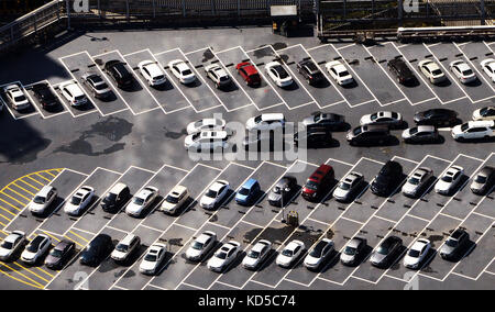 An aerial view of a parking lot with many parked cars. - Stock Photo