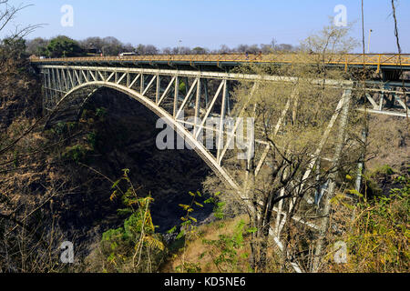 The Victoria Falls Bridge marks the border between Zambia and Zimbabwe in Southern Africa - Stock Photo