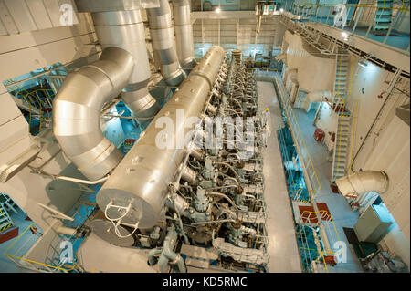 Engine room of container ship CSCL Venus - Stock Photo