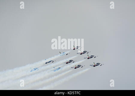Members of the Italian aerobatic team Frecce Tricolore fly in formation at the air show of the Royal Netherlands - Stock Photo