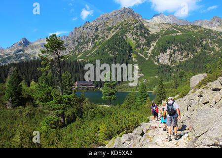 POPRADSKE PLESO - AUGUST 27, 2015: Tourists enjoy summer trekking in High Tatras (Vysoke Tatry) national park, Slovakia - Stock Photo