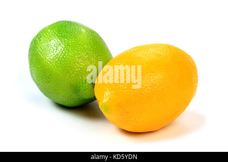 Closeup shot of green and yellow lemons isolated on white background - Stock Photo