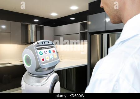 Robotics Trends artificial intelligence technology , smart home concept. Autonomous personal assistant robot waiting - Stock Photo