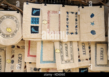 Souvenir bath mats for sale in the Cretan town of Rethymno (Rethimno) on the northern coast of Crete. Rethymno is - Stock Photo