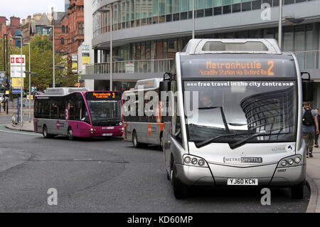 Metroshuttle free buses at Manchester Piccadilly Station - Stock Photo