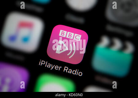 A close-up shot of the company logo representing the BBC IPlayer Radio app icon, as seen on the screen of a smart - Stock Photo