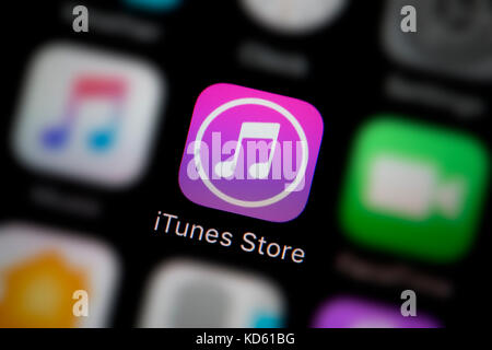 A close-up shot of the iTunes Store app, as seen on the screen of an Apple iPhone (Editorial use only) - Stock Photo