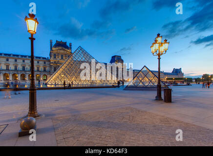 Paris (France): the Louvre Pyramid, a large glass and metal pyramid at the entrance to the museum, designed by architect - Stock Photo