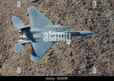 McDonnell Douglas (Boeing), F-15 Strike Eagle, Flying At Low Level Through Rainbow Canyon In Death Valley National - Stock Photo