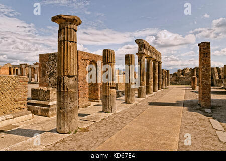 Columns at the Forum area in the ruined Roman city of Pompeii at Pompei Scavi near Naples, Italy. - Stock Photo