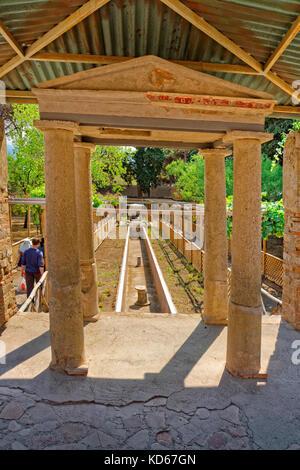 Garden and water course of the Octavius Quarto house at the ruined Roman city of Pompeii at Pompei Scavi, near Naples, - Stock Photo