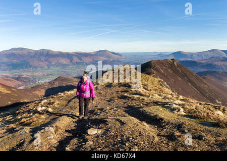 Walker Heading Towards Scar Crags From Causey Pike, Lake District, Cumbria, UK - Stock Photo