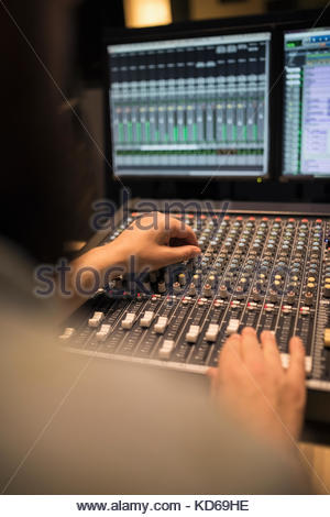 Male music producer working at sounder mixer in recording studio - Stock Photo