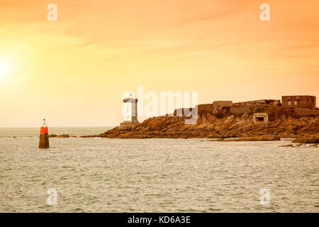 Kermorvan Lighthouse and rocky coastline near Le Conquet, France - Stock Photo