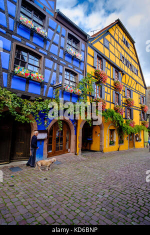 Beautiful, traditional half-timbered houses, decorated with colorful geraniums, storksbills, (Geraniaceae), in the - Stock Photo