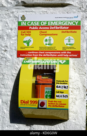 A Public Access Defibrillator attached to the outside wall of the Bath Arms Pub in Crockerton, Wiltshire, United - Stock Photo