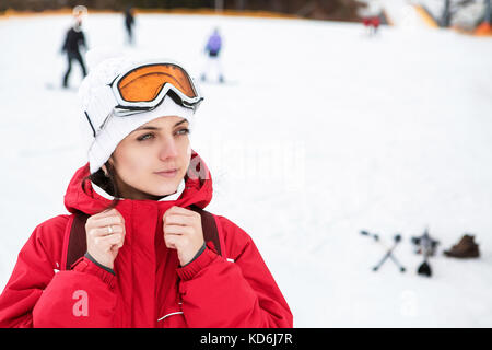 Portrait of a skier woman in ski goggles  - Stock Photo