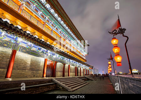 Wide angle lens picture of Xian City Wall at night. Xian was an ancient capital of China and City Wall is one of - Stock Photo