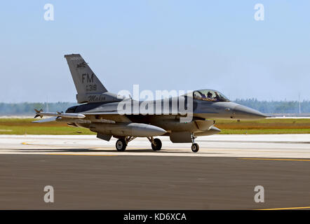 Miami, Florida - November 6, 2010: US Air Force F-16 jet fighter retirning from mission. Homestead Air Reserve Base - Stock Photo