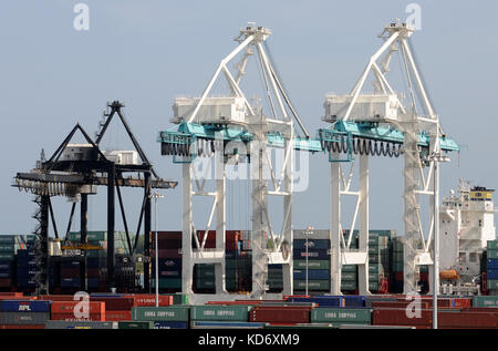 Miami, USA - July 18, 2008: Giant cranes move containers through the port of Miami. it is one of the largest container - Stock Photo