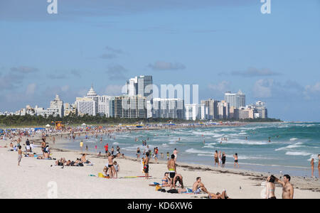 Miami, USA - November 25, 2010: Tourists enjoy a sunny day in Miami Beach, Florida. Winter months a popular time - Stock Photo