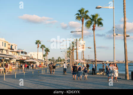 Tourists on the promenade in Kato Paphos, Paphos, Cyprus - Stock Photo