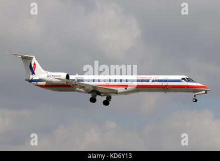 Miami, USA - January 30, 2011: American Eagle regional jet airplane landing at Miami International Airport. American - Stock Photo