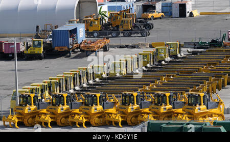 Miami, USA - July 18, 2008: Tractors and other construction machinery awaiting export from the port of Miami. Miami - Stock Photo