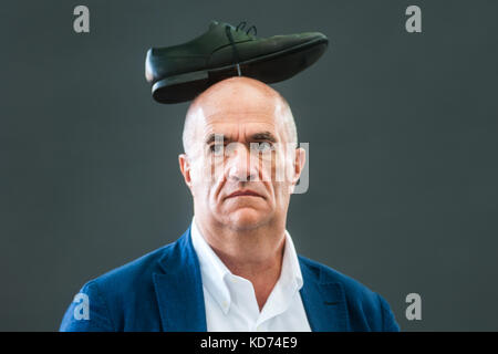 Irish novelist, short story writer, essayist, playwright, journalist, critic and poet Colm Toibin attends a photocall - Stock Photo