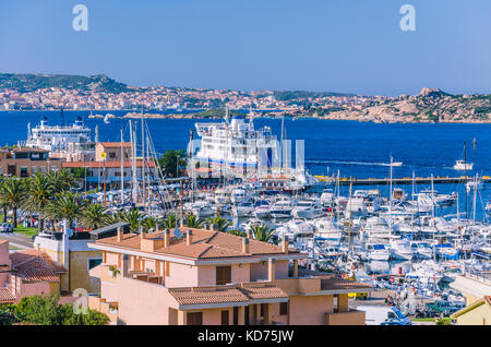 Port of Palau on sardinia island with farry and yacht boats. La Maddalena island in background - Stock Photo