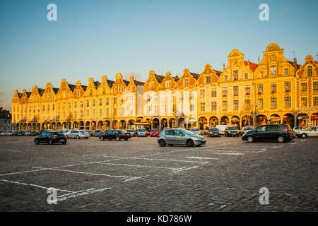 ARRAS, FRANCE - SEPTEMBER 14, 2012: Sunset view of the Main Square (Place des Heros), with locals and visitors, - Stock Photo