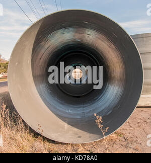 A view inside a pipe that will eventually be used for a sewer line. - Stock Photo