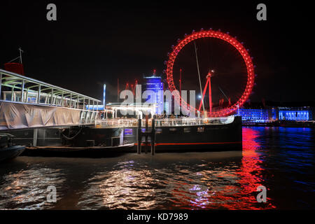 London River Thames night scene including the London Eye and Westminster Pier - Stock Photo