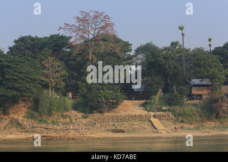 Rock filled timber crib bank protection works on an outside bend of the Irrawaddy River in the Mandalay Region of - Stock Photo