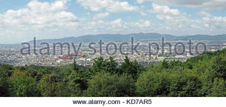 Panoramic view looking down over the cityscape of Kyoto in Japan - Stock Photo