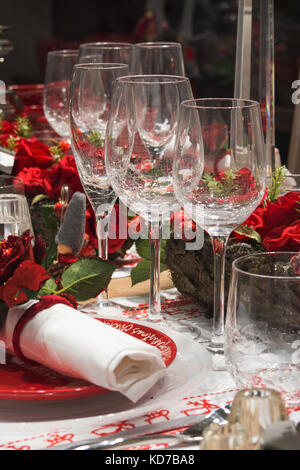 Christmas tableware in red colors - Stock Photo