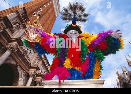 Italy. Venice. Carnival. Man in Bird theme costume. - Stock Photo